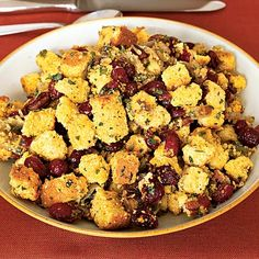 Corn Bread Stuffing With Cranberries - I would adapt this by using vegetable stock instead of chicken