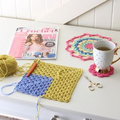 I did a bit of this today. This is a granny square jumper I'm working on made from the luxuriously soft Debbie Bliss Rialto DKthank you kindly for all of your suggestions regarding the border of my granny square blanket. I appreciated all of your ideas White was a popular choice so I'm going to go with rounds in DC with maybe a coloured row....or two.  Mandy xx by crochetbyredagape
