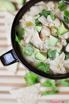 Slow Cooker / Crock Pot Chicken and White Bean Chili ~ garnish with cilantro, tortilla chips, cheese, avocado chunks, salsa, etc.  |  {Five ...