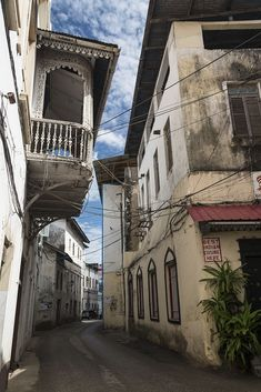 Stone Town Alley Stone Town, Alleyway, Old Buildings, East Africa, Mountain Range, Island, Explore, Adventure, Landscape