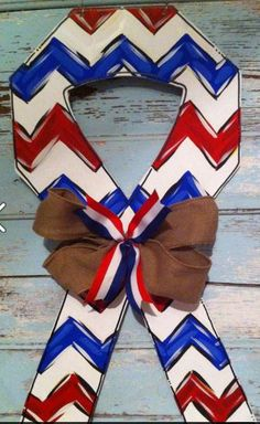 "Chevron Ribbon, red white & blue, 4th of july, year round, USA door hanger. $40 plus 12 shipping. Approx. 24"". Burlap bow. Safe for use outdoors. Check out Blue Pickle Designs on facebook for lots more fun & super trendy door hangers! Be sure to 'LIKE' our page to receive updates & news about our latest sales & specials! New & ready to ship items added regularly!"
