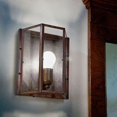 Wall lamp with structure in antique brass and clear glass plates is perfect for interior lighting. Interior Lighting, Lighting Design, Clear Glass Plates, Aldo, Sconce Lighting, Candle Sconces, Antique Brass, Living Spaces, Wall Lights