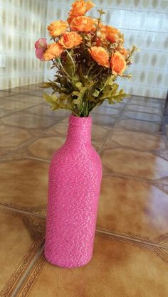 Juice bottle decored with Pink thread.