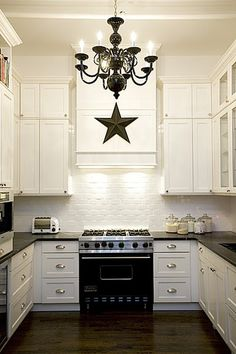 Love the contrast of the white brick backsplash and the walnut floor    Tending toward this look so there isn't black cabinets right up against the cherry floor. Would do iron hardware though.