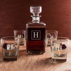 A stately gift that will make your best man, groomsman or any guy on your gift list will gleam with satisfaction and pride, this 5 piece 34 ounce square glass whiskey decanter and 11 ounce rocks glasses set personalized with a large single block initial will make the perfect compliment to any home bar or liquor cabinet. This whiskey serving set can be ordered at http://myweddingreceptionideas.com/personalized-glass-whiskey-decanter.asp