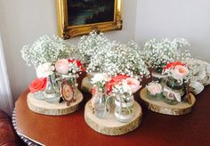 Rustic wood slices as centrepieces buy preloved at www.sellmywedding.co.uk