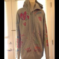 Victoria's Secret hoodie graffiti doodle NWT, size m or l. Paid $77. Heather gray/ grey with colorful graffiti or doodles all over. Pink line from Victoria secret Victoria's Secret Tops Sweatshirts & Hoodies