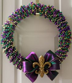 12 Creative Ways To Reuse and Recycle Your Mardi Gras Beads - 12 Creative Ways . - 12 Creative Ways To Reuse and Recycle Your Mardi Gras Beads – 12 Creative Ways To Reuse and Recy - Couronne Diy, Mardi Gras Wreath, Mardi Gras Decorations, Mardi Gras Beads, Mardi Gras Party, Candle Decorations, Masquerade Decorations, Masquerade Ball, Craft Rooms