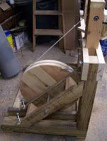 Guest Post by WoodChux      Continuous Motion Treadle Lathe   Here's an inexpensive, portable  treadle lathe design that you can make in a ...