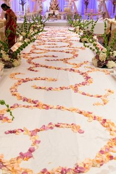 Wedding aisle designed in ornamental patterns made from rose petals | Indian Telegu Wedding by Lauren Reynolds