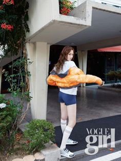YG Entertainment actress and model Lee Sung Kyung strikes athletic pose for 'Vogue Girl' | allkpop.com