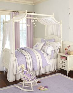 purple and white with a light grey wall and purple curtains. from pottery barn