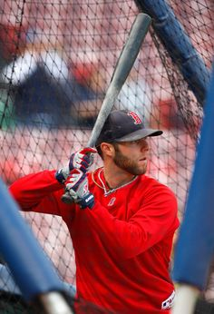 Dustin Pedroia #15 of the Boston Red Sox takes batting practice before game three of the American League Championship Series against the Tampa Bay Rays during the 2008 MLB playoffs at Fenway Park on October 13, 2008 in Boston, Massachusetts.   (October 13, 2008 - Source: Jim Rogash/Getty Images North America)