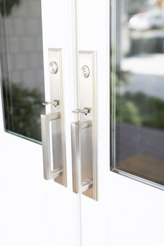 Exterior of Tori Wesszer's grey shake home Emtek door hardware