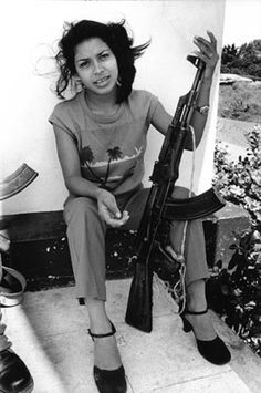 Marta Lorena on guard duty at the main telecommunications office, Managua, Nicaragua 1984