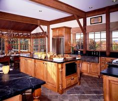 The Somerset Barn Home post and beam kitchen. Click thru for more pics & downloadable fl plns. #barnhomeplans #barnhouses #barnhouseplans #timberframe