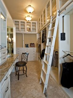 Master closet with a rolling ladder..