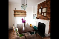 """Love Sophie  Dale's, from """"The Block"""", dining room from the homemade lamp fitting using old jars, to the assorted collection of mirrors, to the dresser and contrast of red and aqua."""
