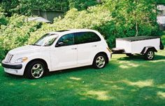 white PT Cruiser with utility trailer that was painted to match