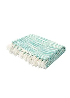 This soft, hand-loomed throw is ideal for snuggling up on cool spring evenings. The sea green hues in subtle wavey stripes, create a pattern that coordinates well with outdoor living at the beach.