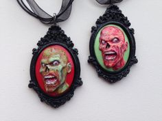 Well these sure caught my eye..Polymer Clay Zombie Cameo by InkedFish