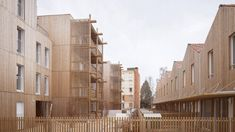 Odile Guzy Architectes covers social housing with vertical wooden slats