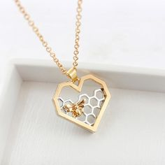 This heart shaped necklace is simply BEE-utiful modern two-tone design Dainty and elegant Would make the perfect gift for a friend or family member or go ahead and spoil yourself, we won't judge. Heart Jewelry, Jewelry Gifts, Jewelry Party, Simple Jewelry, Women's Jewelry, Jewlery, Unique Necklaces, Silver Necklaces, Women's Necklaces