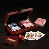 "Potential clients will ""deal in"" with your company when you feature our Card and Dice Set during an upcoming event. There are two decks of cards and five dice included in this attractive wooden box with metal hinges and clasp. This lovely gift is great for gaming with family and friends. Add your logo to this polished product and present this item as a prize during upcoming fundraising events. Enhance your brand by ordering this terrific set today.  Complies with Prop 65.  7.375&quo..."