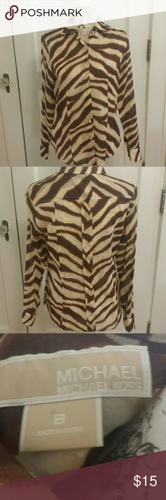 "MICHAEL Michael Kors. Brown, cream animal print,  button down, sheer, 22"" long, detailing on back, 100% cotton. MICHAEL Michael Kors Tops Button Down Shirts"