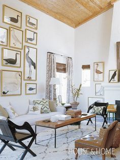 "Decorate with avian artwork and tribal prints for a West Indies vibe.   This room makes a neutral palette dynamic and interesting. ""The scale of this room, emphasized by the gallery wall, is impressive and it's a great representation of how to be bold while keeping the colours neutral,"" says Burnett."