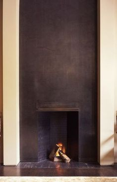 Black plaster fireplace.