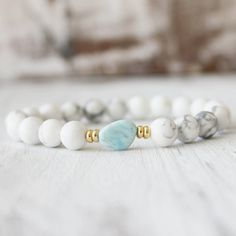 Calming Larimar Bracelet Simple and unique. Perfect for Everyday    Details:  8mm High quality white howlite.  Genuine Larimar nugget guru