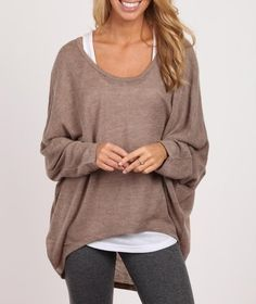 oversized sweater with tank and leggings. That looks like me leaving the gym in the winter time. lol