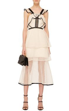 Intricate and feminine lacework characterizes this **Self Portrait** tier dress in off white accented by black hems.