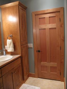 Interior Doors | 6 panel Oak door in the bathroom with flat panels that match the cabinets | Bayer Built Woodworks