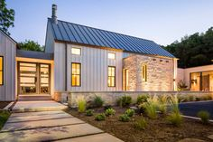Image from http://yacineaziz.com/wp-content/uploads/2014/10/Delightful-Modern-Farmhouse-Plans-decorating-ideas-for-Exterior-Farmhouse-design-ideas-with-Delightful-concrete-steps-limestone.jpg.