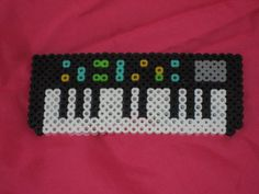 Fuse perler Bead Keyboard Magnet by Pearler Bead Patterns, Perler Patterns, Pearler Beads, Loom Patterns, Basson, Hama Beads Design, Music Crafts, Fusion Beads, Iron Beads