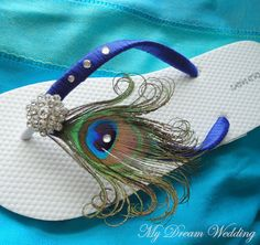 I want these for my wedding! Cute, comfortable, no heel, and the peacock feather would be a PERFECT match!