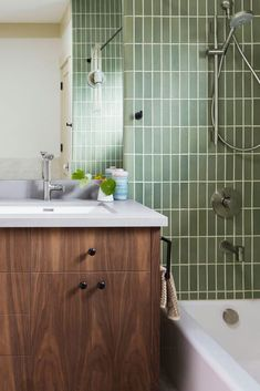 green tiles and walnut cabinets