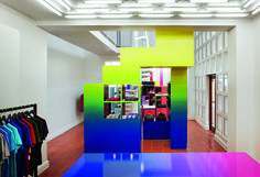 Unknown Union Men's Boutique in Cape Town. The two-level boutique, located in a historic building, exudes light and color. On the first level, white walls serve as the background to the pared-down stacked-box shelving painted in softly muted yet vibrant colors. This simplified setting, gives the owners, Sean Shuter and Daniel Jackson, an ideal showcase for the brands that they represent.