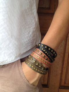 Double wrap leather bracelet with brass pyramids and studs. Available in Black, Tan, Olive on Etsy, $12.00