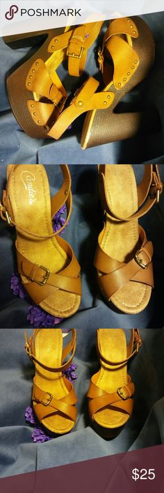 Candies vintage sandal Never worn candies caramel colored leather sandal. criss cross over the top of your foot Buckle closure around your ankle. block heel platform not a bit of wear. still plastic on one of the buckles beautiful retro shoe size 10 candies Shoes