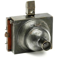 Photosphere  c1890 Compagne Française de Photographie, Paris, France. One of the first all-metal cameras, invented by Napoleon Conti 1888. Spring powered hemispherical sector shutter with variable speeds. Attached is a removable reflecting view-finder. This example, serial no 201, for 9x12 cm plates held in double dark slides. from http://www.photographica.nu/photosphere.htm