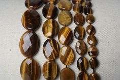 Details:  Type:Opals/Tiger Eye Category: Stone Beads Size: 8*10/10*14/13*18/18*25mm Shape: Section Oblate Oval Color: White/Yellow Unit: Sold By 1 Strand Beads ID:JDYXQTY011/JDYXQTY012  **************************************************************************************************** ★ DISCOUNT (A coupon code can be used before checking out.)  5% OFF on order $30 and above (Coupon Code: BEADS05 ) 6% OFF on order $50 and above (Coupon Code: BEADS06 ) 8% OFF on o...