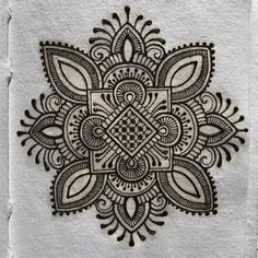 I'm rather enjoying this 'henna on paper' thing...just weird and wonky little designs with no purpose whatsoever.Very relaxing.