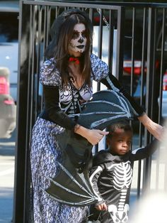 Sandra Bullock and her three-year-old son Louis go all out for Halloween in matching (and spooky!) skeleton costumes. The actress -- whose elaborate ensemble was in homage to the traditional Mexican holiday Dia de Los Muertos (Day of the Dead) -- and her little guy make their way to a Halloween party at his school in Sherman Oaks, Calif., on Oct. 19