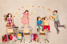 Classmates sit at their desks in school and munch on fruit that is being passed around...