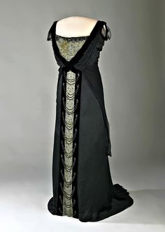 First Lady Edith Wilson's Evening Dress. Black charmeuse satin trimmed with beads, black velvet, and white net, from the House of Worth in Paris. The first lady wore the dress in 1915 for a private dinner party at the White House. Via The Symmetric Swan.