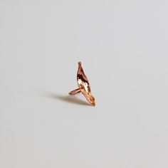 Inspired bythe beautiful and unique this striking one of a kind hand-made  producthas been created using a specialised technique to apply a thin  layer of copperto a found objectultimatelygiving it another life.  Inner ring diameter - 17mm  Length - 42mm  Width - 11mm