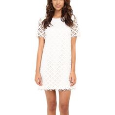 """Catherine Malandrino White Dress Beautiful white Lacey """"Courtney"""" dress. Brand new with tags! All polyester but the lining also has 3% spandex for a tiny tiny stretch. The lining is nice and satiny. Comes with an extra button. Catherine Malandrino Dresses Mini"""
